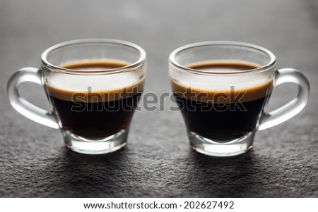 Two small glasses of fresh espresso - stock photo
