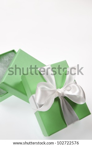two small green box tied with a white ribbon - stock photo