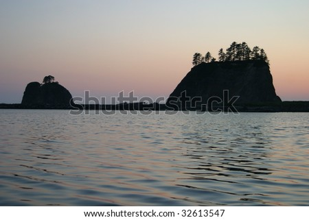 Two small islands off the Washington coast on the La Push Indian Reservation in silhouette. - stock photo