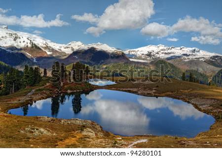 Two small mountain lakes on a plateau - stock photo