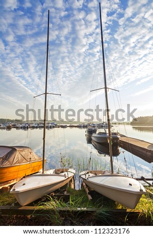 Two small sailboats on the coast of Saimaa lake in Imatra town, Finland - stock photo