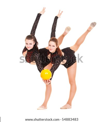 two smiley gymnasts posing with yellow ball. isolated on white background - stock photo