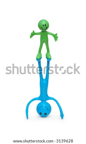 Two smilies performing acrobatic exercises  isolated on white