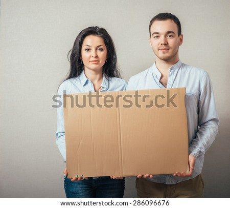two smiling at a blank board - stock photo