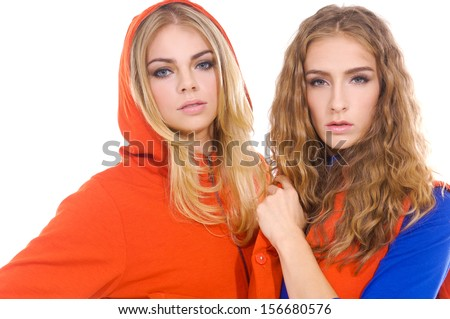 Two smiling attractive blond girl friends Two smiling attractive blond girl friends  - stock photo