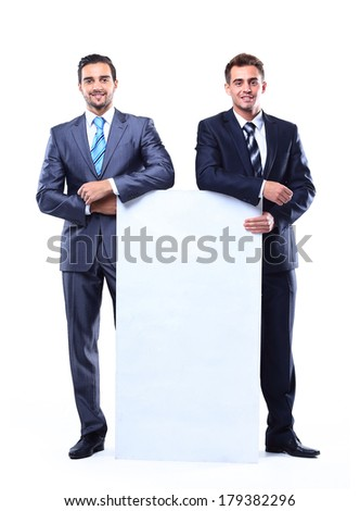 Two smiling business man showing blank signboard, isolated over white background - stock photo