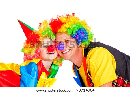 Two smiling clowns, over white - stock photo