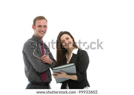 Two smiling confident young businesspeople standing together sharing information in a successful business partnership - stock photo