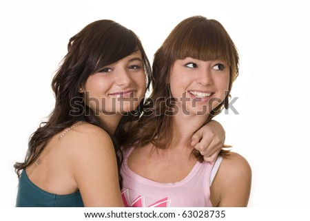 Two smiling girls. White background - stock photo