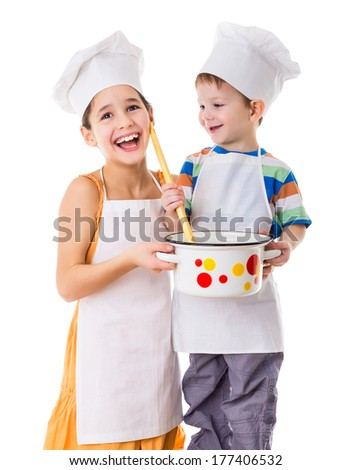 Two smiling kids with pan and big ladle, isolated on white