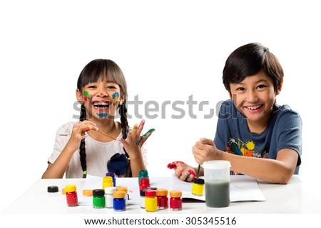 Two smiling little kids at the table draw with water color, Isolated over white - stock photo