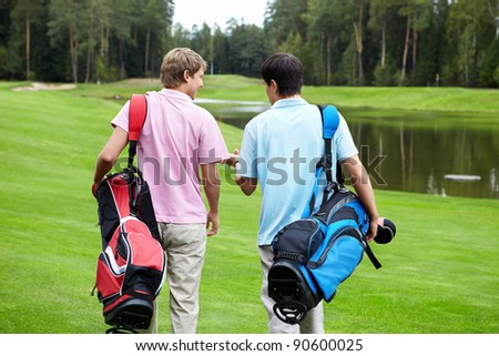 Two smiling men on a golf course - stock photo