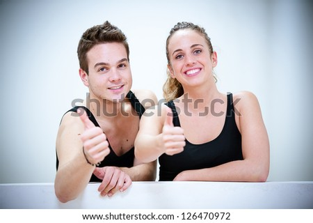 Two Smiling Persons after Fitness Exercises,Italy - stock photo