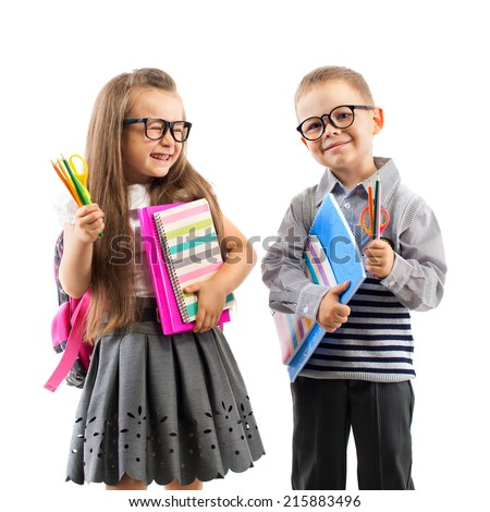 Two smiling school kids with colorful stationery, isolated on white background. School, education concept. - stock photo