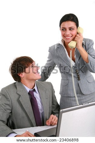 Two Smiling Young Business Persons Working in Office - stock photo
