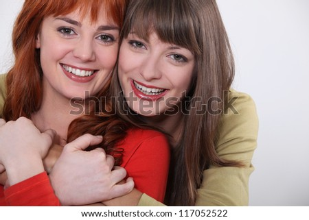 Two smiling young women - stock photo