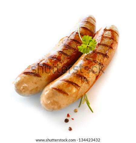 Two smoked sausage against the white background - stock photo