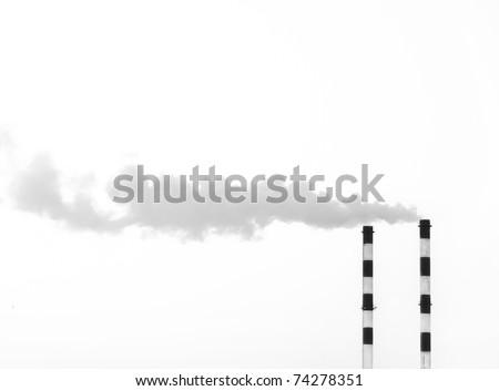 Two smoking chimneys / black and white / - stock photo