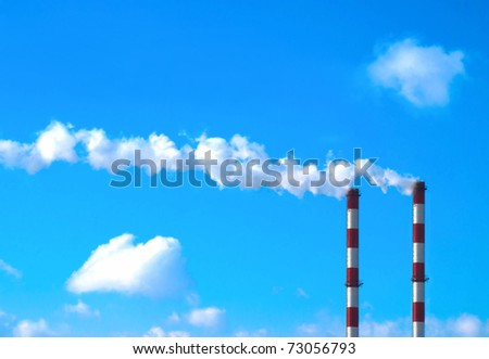 Two smoking chimneys / Pollution / Power plant - stock photo