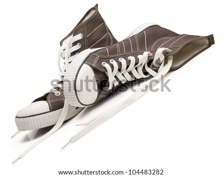 Two sneakers isolated on a white background. - stock photo