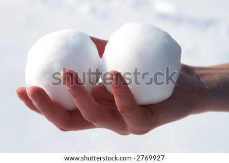 Two snowball in the hand - stock photo