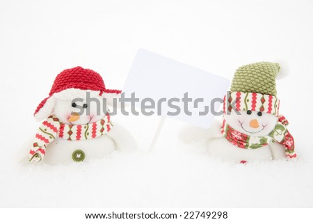 Two snowman with the white  board on hand - stock photo