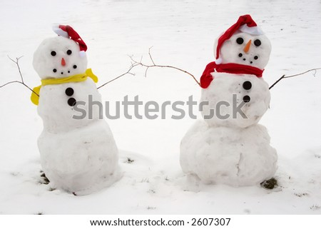 Two Snowmen - A lovely couple ( snowman ) - stock photo