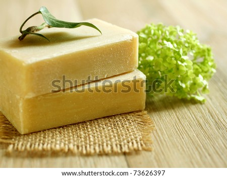 Two soap and green leaf on wooden.Spa products