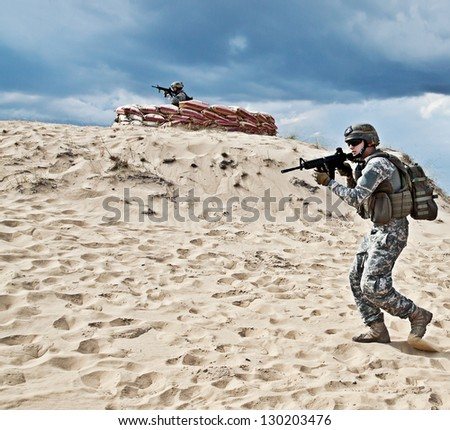 Two soldiers - stock photo
