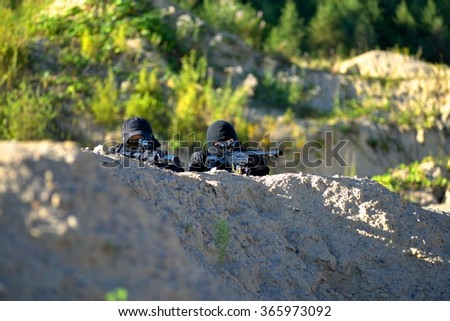 Two soldiers in action - stock photo
