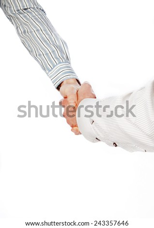 Two solid men shake each others hand - stock photo