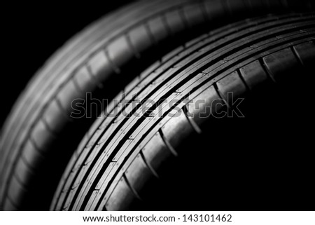 Two sport tires isolated on black background - stock photo