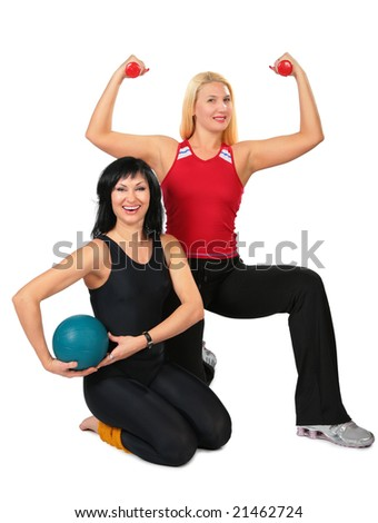 Two sport women with ball and dumbbells - stock photo