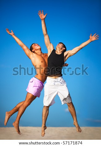 Two sportsmans jumping up high. - stock photo