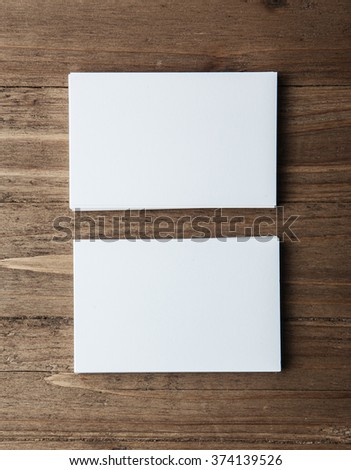 Two stack of blank white business cards on wooden background Vertical - stock photo