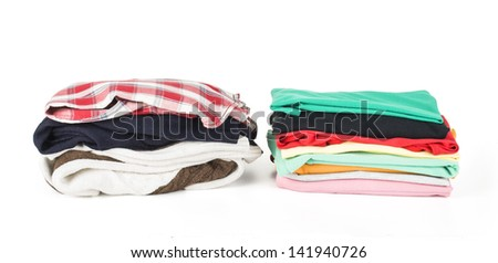 Two stack of clothing isolated on white - stock photo