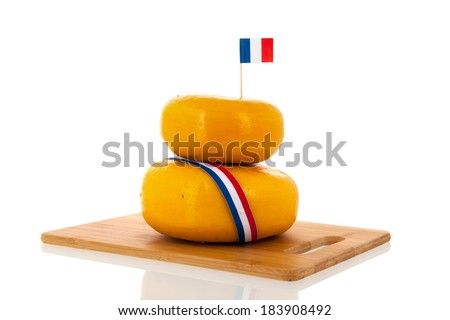 Two stacked whole French cheeses isolated over white background - stock photo