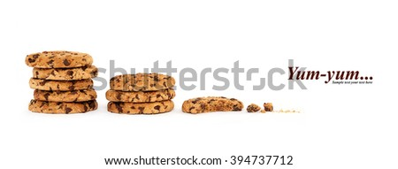 Two stacks of eight delicious chocolate chip cookies next to a partially eaten one with crumbs. Template design isolated on white with copy space and sample text - stock photo