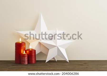 Two stars with three red candles as Christmas deco - stock photo