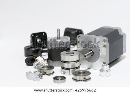 two stepping motors and mechanical parts - stock photo