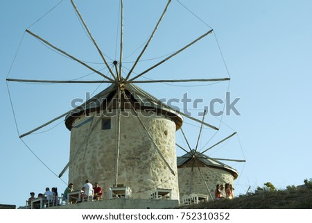 Two stone windmills of Alacati which had been built at 1850 and later had been rebuilt by Cesme Municipality in Alacati street in Cesme Alacati,Cesme, Izmir,Turkey- July 5, 2014
