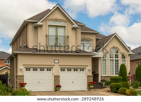 Two storey house with a nice landscaping - stock photo