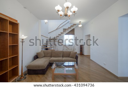 Two-storey studio apartment. Interior. A wooden staircase.