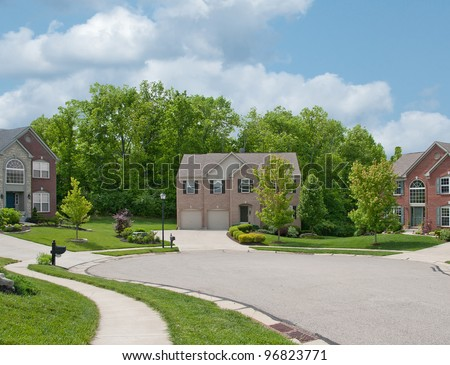 Two-Story Brick and Vinyl Siding House - Back yard of a two-story vinyl siding houses in the suburbs in America.