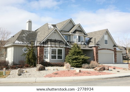 Two story gray house with red bricks