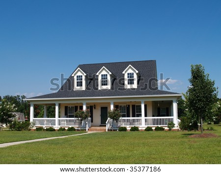 Two story residential home with vinyl or board siding on the facade. - stock photo