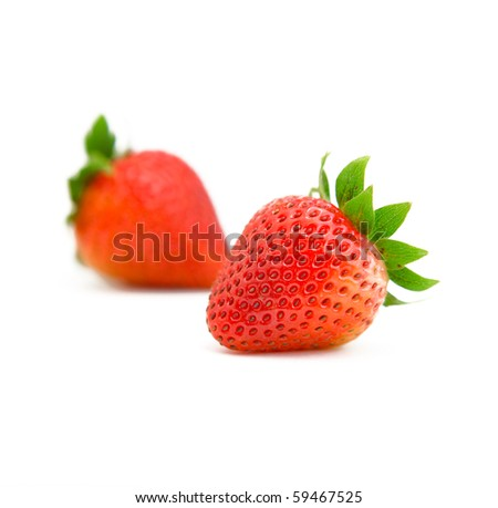 two strawberries on white background - stock photo