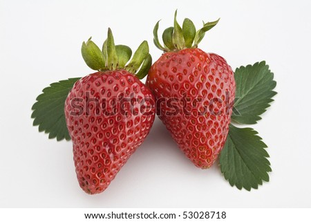 Two strawberries with leaf isolated - stock photo