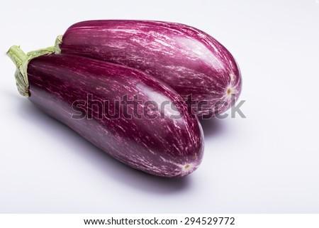 two striped eggplants on white background - stock photo