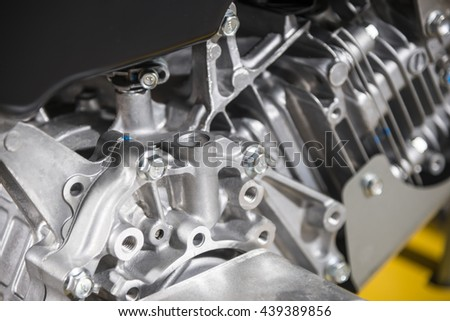 Two-stroke engine of the building machine - stock photo
